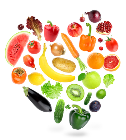 Falling fruits and vegetables on white background. Healthy food concept. Fresh food