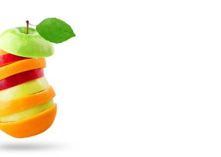 Stack of apple and orange slices on white Banco de Imagens