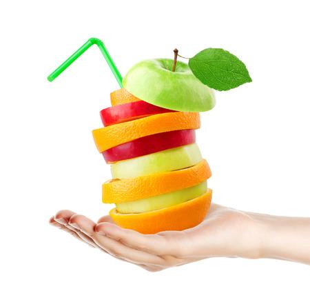 Fruits stack. Hand holding mixed fruit on white