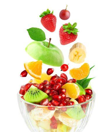 Mixed fruits on white background. Fruit salad. Falling fruits. 版權商用圖片