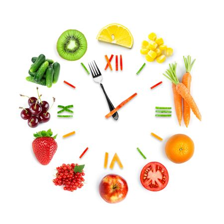 Food clock with fresh fruits and vegetables.