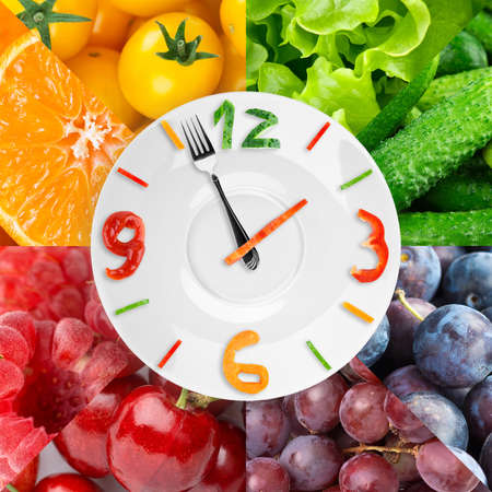 Food clock with fresh fruits and vegetables. Healthy food