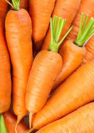 Fresh carrots. Carrot background. Fresh ripe vegetables 版權商用圖片