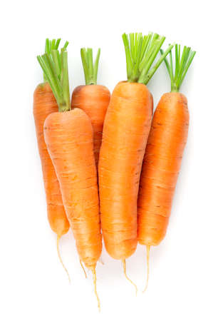 Carrot on white background. Fresh ripe vegetables. Top view