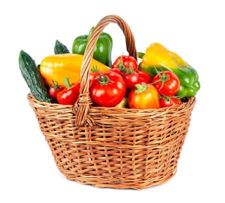 Vegetables in basket on white background. Fresh food