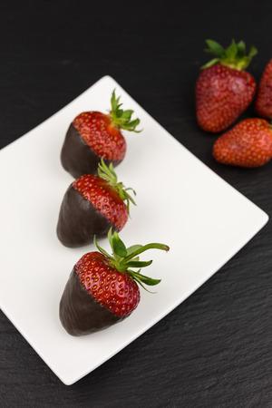 assorted petite: red strawberries dipped in dark chocolate