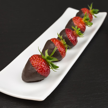 dipped: red strawberries dipped in dark chocolate