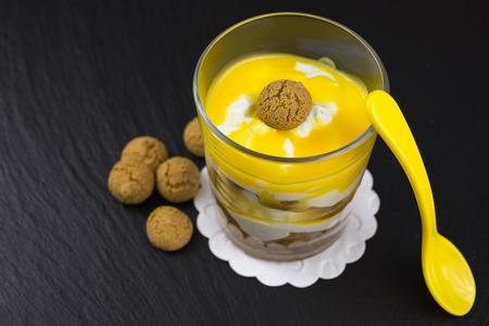 amaretto: layered dessert of mascarpone and curd on amarettini with amaretto and egg liquor on top Stock Photo