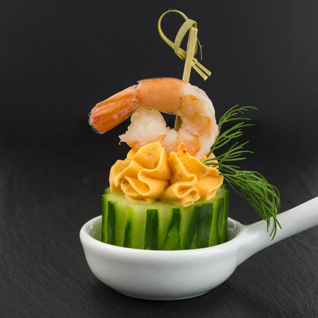 fingerfood: fingerfood of cream cheese with shrimp on cucumber Stock Photo