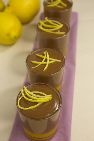 zest: chocolate mousse on mango puree  decorated with lemon zest