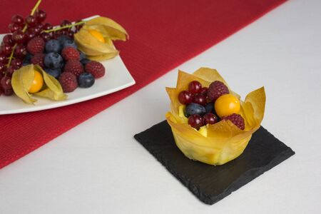 filo: mini cheesecakes with filo pastry and different berries on top