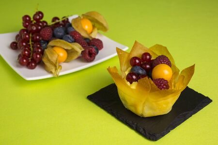 filo pastry: mini cheesecakes with filo pastry and different berries on top
