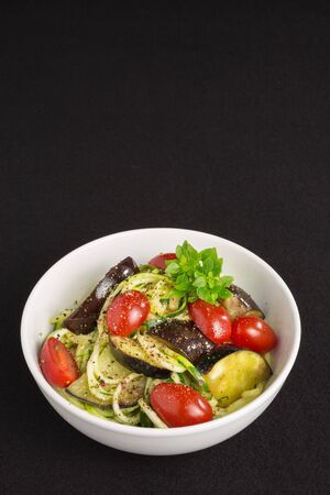 spiralized: vegetarian zucchini noodles with cherry tomatoes, eggplant, pepper and tiny-leafed basil