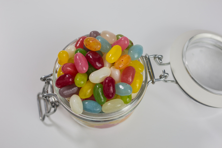 flavors: jelly beans of different colors and flavors in a glass jar