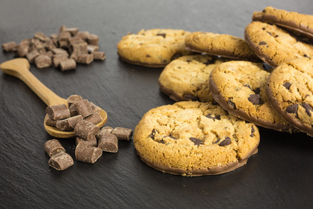 chocolate chip cookies: chocolate chip cookies with wooden spoon and chocolate chips