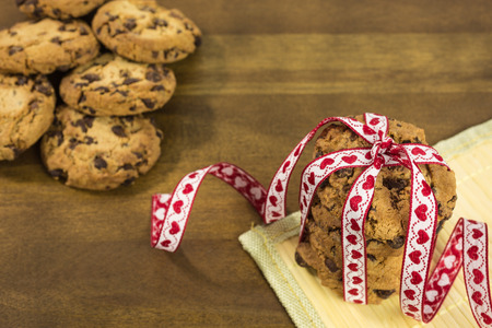 chocolate chip: pile of chocolate chip cookies with ribbon