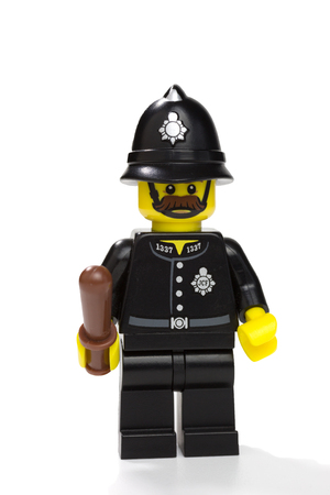 constable: FLOERSHEIM, GERMANY - NOVEMBER 15: LEGO minifigure police constable from LEGO minifigures series 11 on November 15, 2015 in Floersheim, Germany. The LEGO Group, based in Denmark, is the biggest toy manufacturer worldwide and its minifigures are extremly p