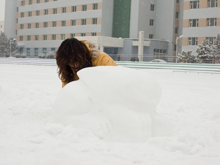 girl squatting: Girl is playing the snow