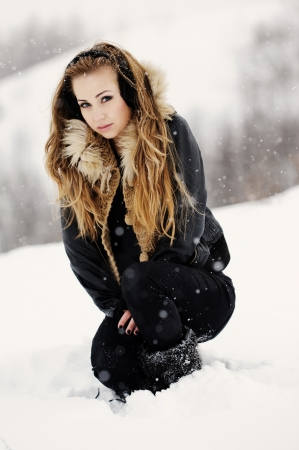 wind down:  Beautiful young girl playing in the snow Stock Photo