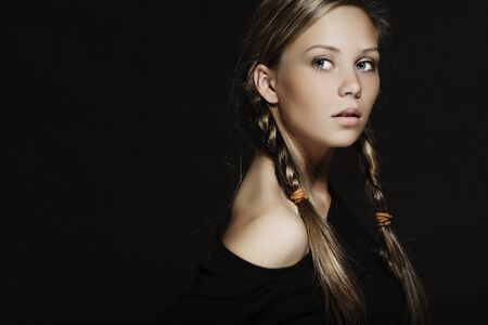 Young girl with plaits in hair photo