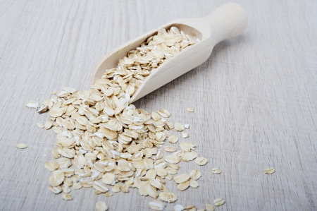 Oatmeal flakes scattered on a light  photo