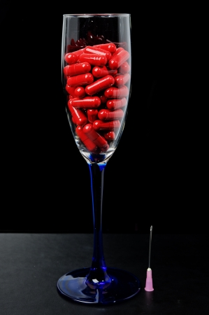 Red capsule in a glass dish photo