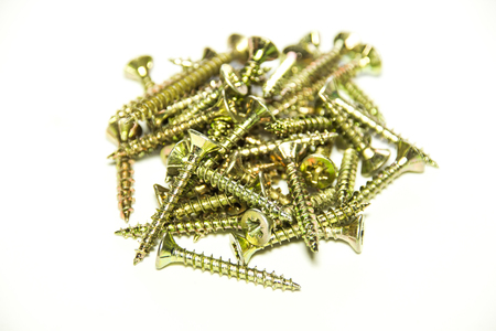 Golden screws close-up on white background Stock Photo