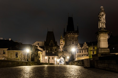 Charles Bridge in Prague with lanterns at night