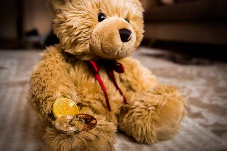 Teddybear and bitcoin Stock Photo