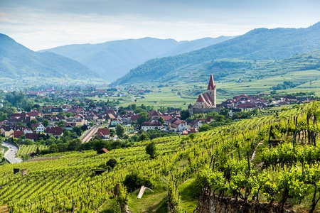 Scenic View into the Wachau with the river Danube and town Weissenkirchen in Lower Austria.