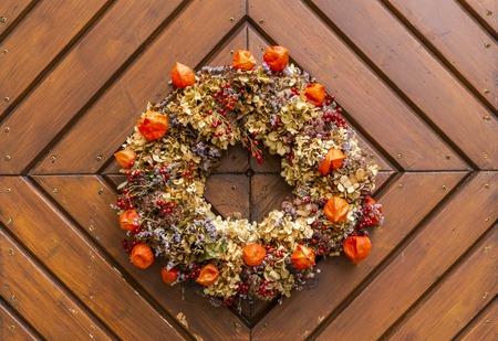 Autumn flower wreath on wooden door decoration