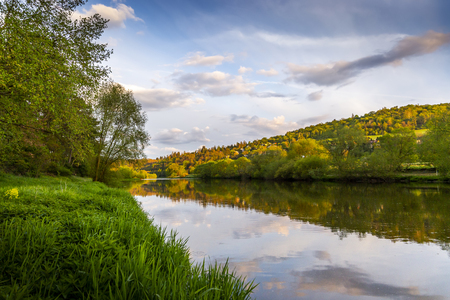 View of picturesque landscape of green hill and Berounka river. Czech Republic.