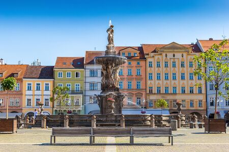 Main square with Samson fighting the lion fountain sculpture and bell tower in Ceske Budejovice. Czech Republic.