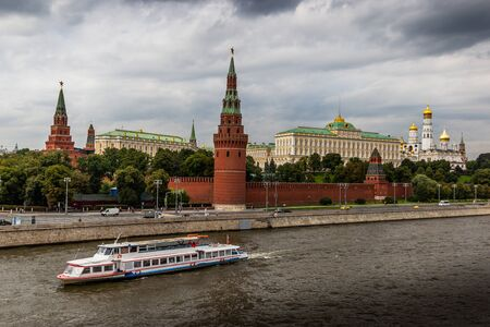 Tourist ships floating on the Moscow river against the background of the Moscow Kremlin. Summer day.