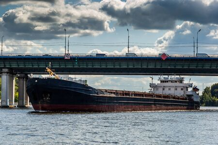 Dry cargo ship on the Moscow Canal river in summer day.