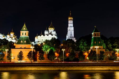 Illuminated Moscow Kremlin, Kremlin Embankment and Moscow River at night in Moscow, Russia.