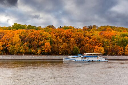 Boat with tourists at the Moscow river. Autumn day.