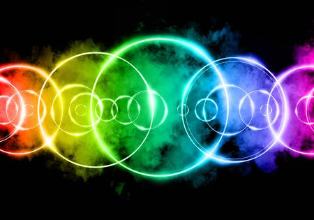 Colorful glowing rings. A magical power of fire and smoke as a background and a beautiful design.