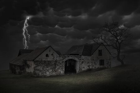Scene of haunted house with thunderbolt in a dark sky. Old house at night. Reklamní fotografie