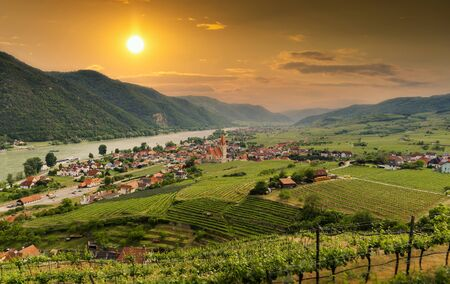 Scenic view to Wachau valley with the river Danube and town Weissenkirchen on a sunset. Lower Austria.