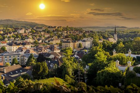 View of the buildings and roofs of the picturesque town of Melk on a sunset, Lower Austria, Wachau Valley.