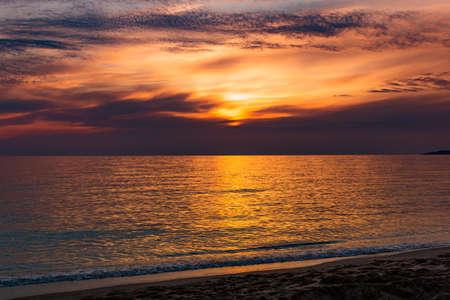 Sunset over ocean. Summer evening. Standard-Bild