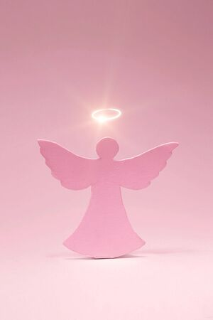 Angel cut out from a cardboard with a shone nimbus photo