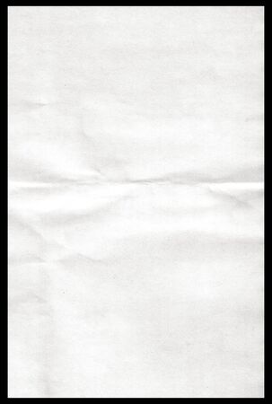 blank poster: White paper pulled out from a notebook on a black background