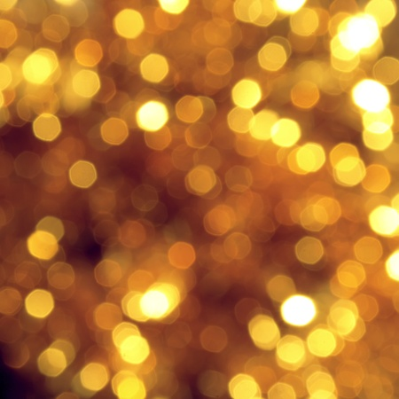 Bright abstract background with golden bokeh Stock Photo