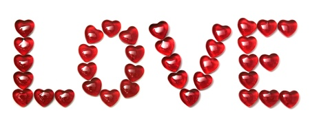 The word love is made of small glass hearts Stock Photo - 8683100