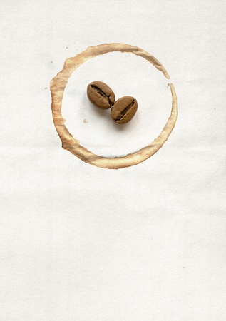 Spot on the cup and coffee beans on paper photo