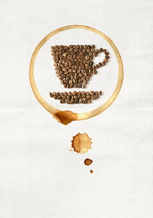 Cup of coffee made from coffee beans on white paper photo