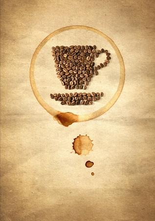 Cup of coffee made from coffee beans on paper photo