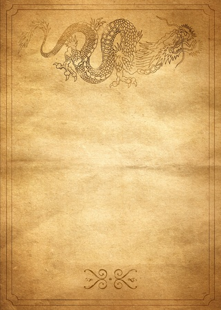 mythological: Old yellow paper with a painted dragon